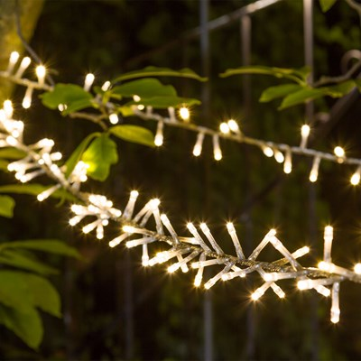 Guirnalda de luces LED a modo de liana con cable transparente