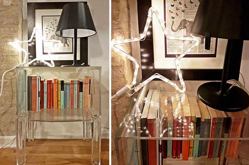 Stella luminosa in soggiorno sulla mini libreria