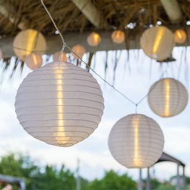 Catena 8 m, 10 lanterne Ø 20 cm, led bianco caldo, cavo trasparente, prolungabile