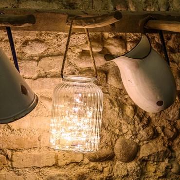 Tarro de cristal con luces Led y asa de rafia  h. 26,5 cm