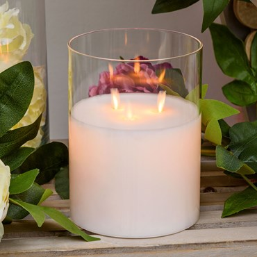 Pillar Candle in clear glass cylinder, white wax, 3 flames, h 20 cm, Ø 15 cm, warm white LED