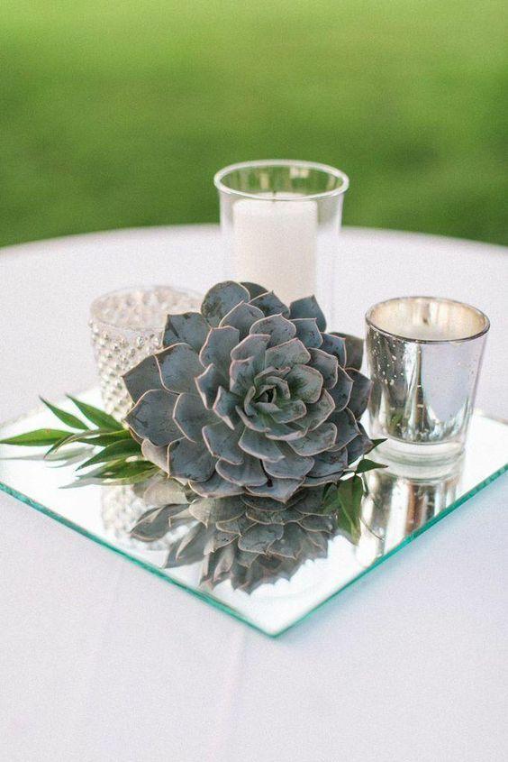 centre de table avec bougies et cactus